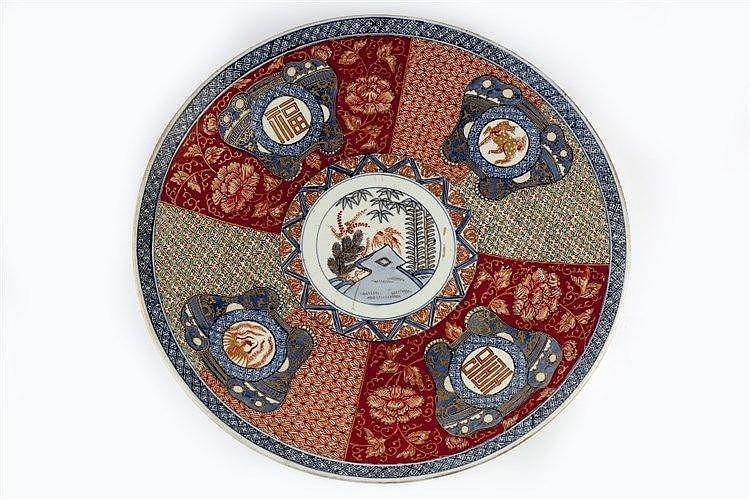 A Japanese Imari charger 19th Century decorated with iron red, aubergi