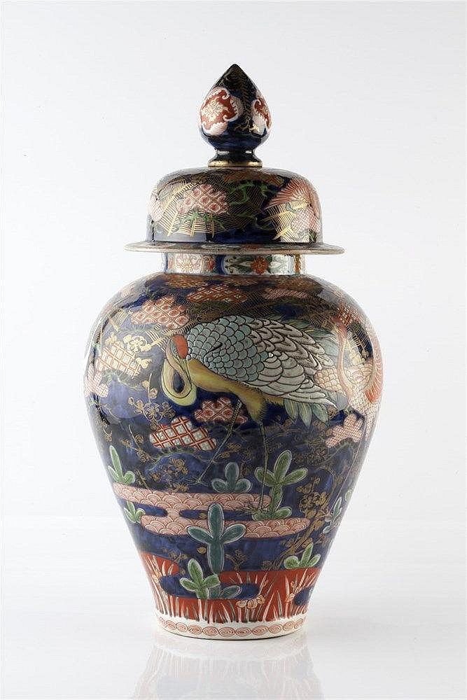 A Japanese cobalt blue ground Arita vase and cover19th Century painted