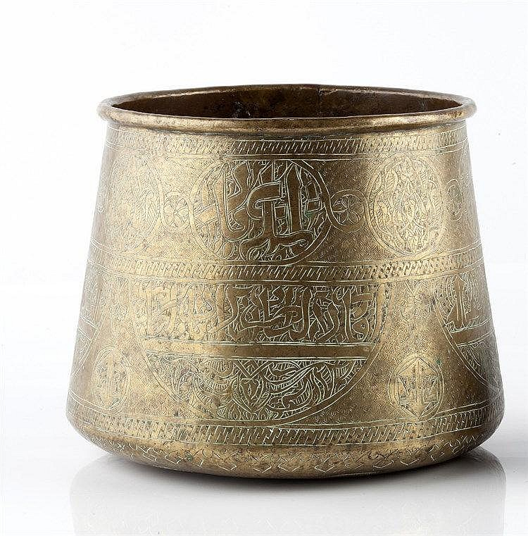 An Islamic brass bowl 19th century of tapering form, inscribed with sc