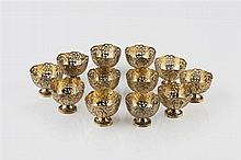 Twelve silver gilt Turkish Zarf bowls 19th century each with a splayed