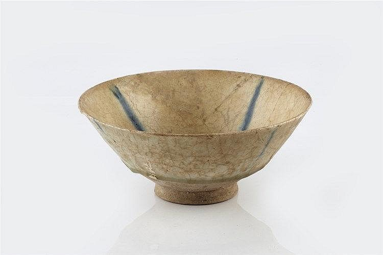 A Persian bowl13th Century of white glaze with four radiating blue lin