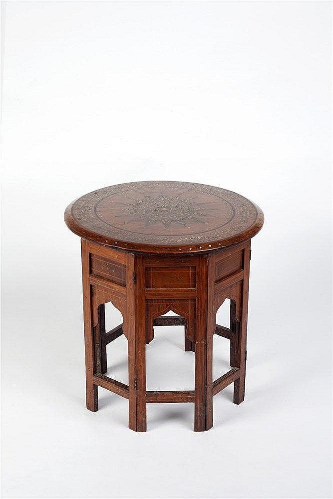 An Anglo-Indian side table with brass and ebony inlaid circular top on