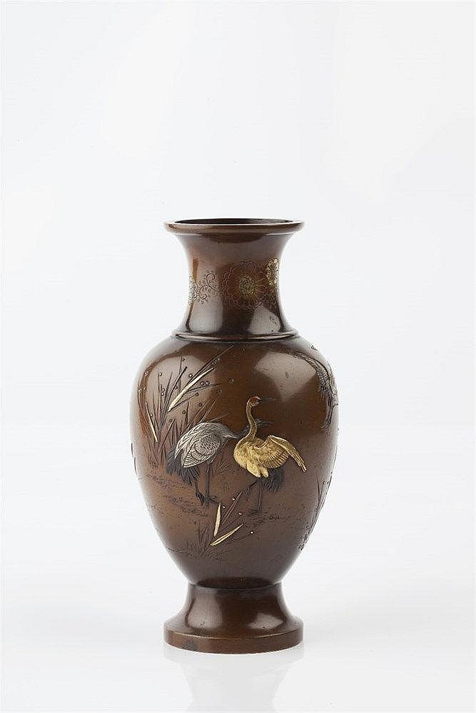 A Japanese bronze vase Meiji period signed Inoue, inlaid in gold,