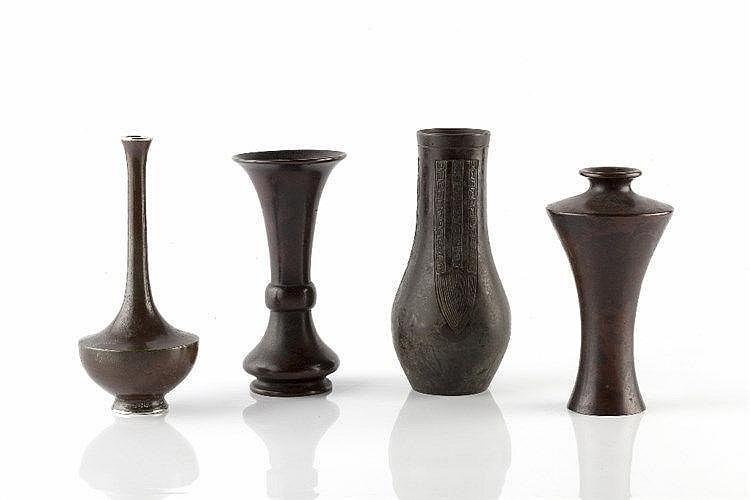 A Japanese bronze iIkibano vase late Meiji of squat bottle form w