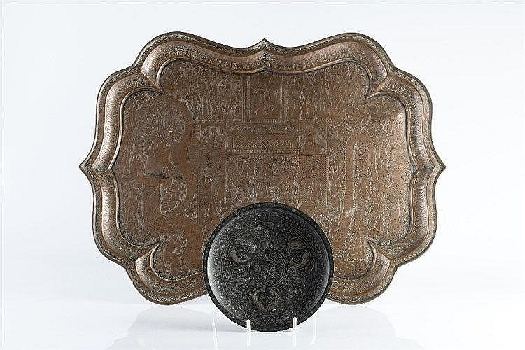 A Persian brass tray of pointed form with engraved pictorial scenes an