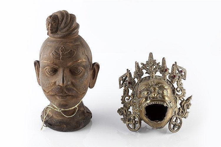 A Tibetan bronze metal Buddha head19th/20th Century the figure with op