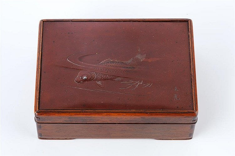 A Japanese wood box with inset bronze panel Meiji period signed G
