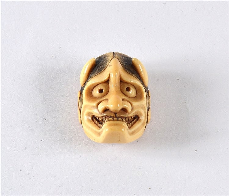 An ivory netsuke mask of Hannya mid 19th Century signed Kikugawa,