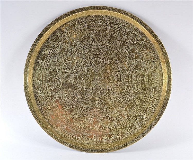 A Qajar engraved brass tray decorated with animals, figures and mythic