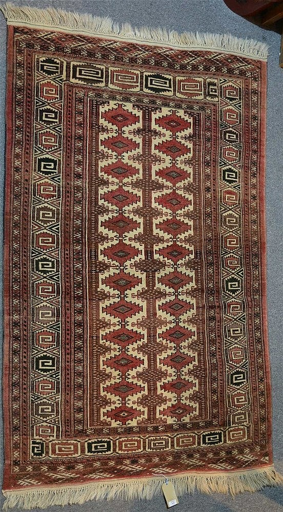 An Afghan rug with central medallion and geometric border, 201cm x 130