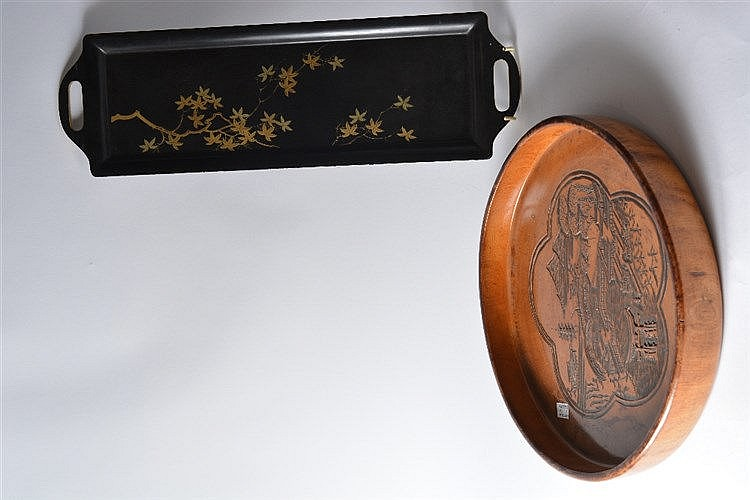 A Japanese wood tray of circular form, engraved with a five petalled p