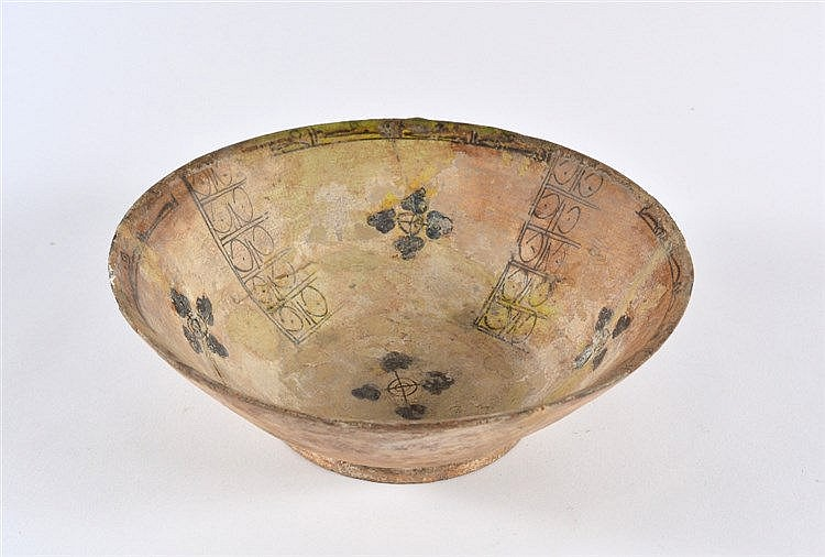 A Mesopotamian bowl 9th Century with alternate bands of designs and fl