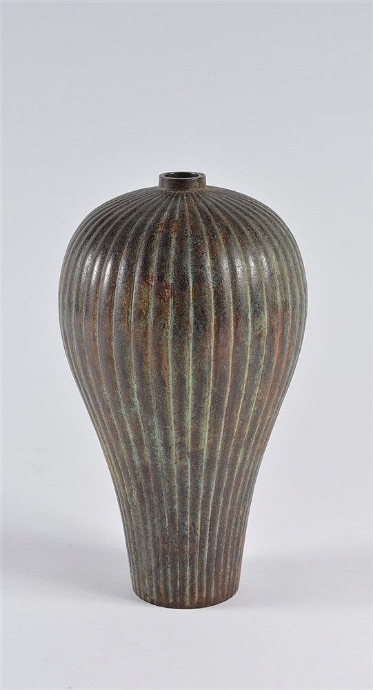 A Japanese bronze vase Meiji period of inverted baluster form wit