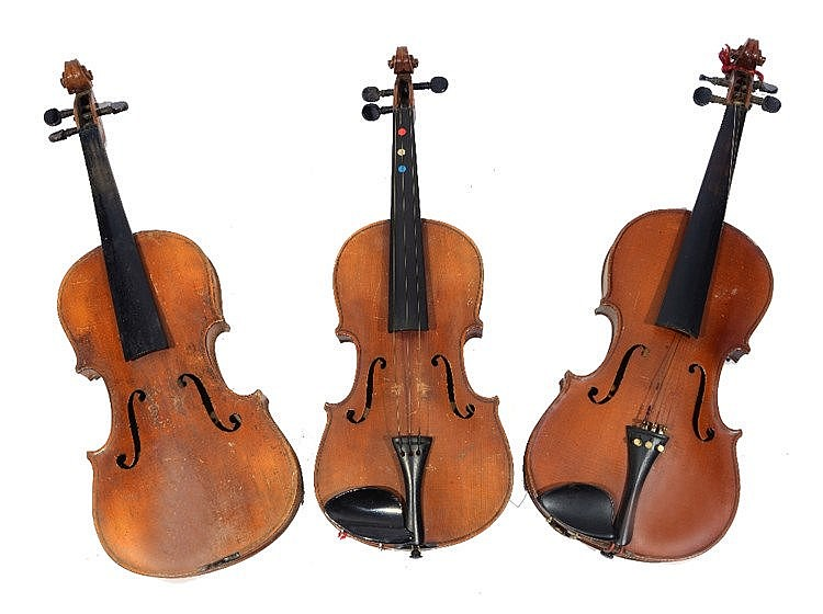 AN OLD VIOLIN WITH TWO BOWS; and two further violins, each with bows, all c