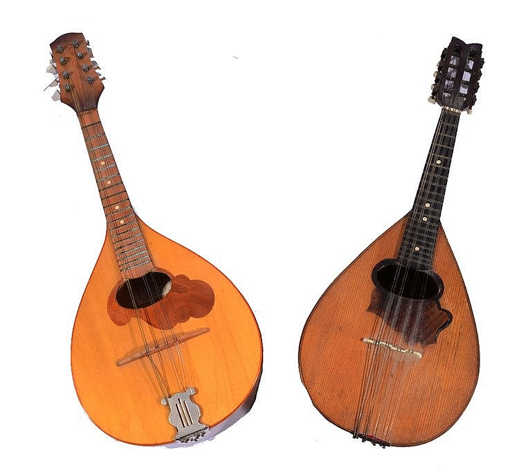 AN OLD BEECHWOOD AND PINE MANDOLIN, the interior marked with initials 'E.W.