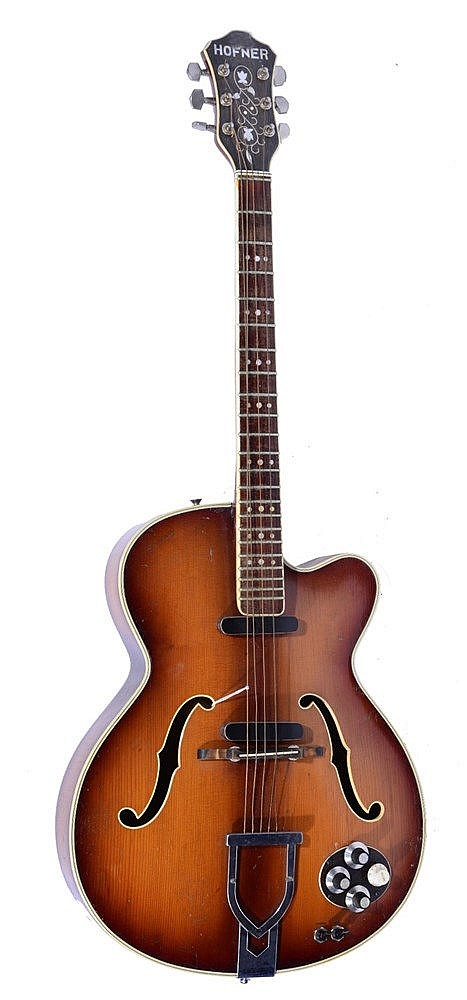A HOFNER ELECTRIC GUITAR with ivorine stringing and chromium pegs.