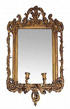 A CONTINENTAL GILTWOOD GIRANDOLE MIRROR with foliate swag and acanthus orna