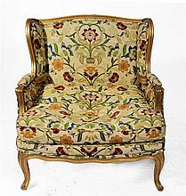 A FRENCH GILTWOOD ARMCHAIR with polychrome foliate upholstery and loose squ