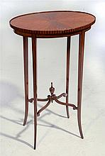 AN OVAL SATINWOOD OCCASIONAL TABLE with four splay legs, c1900, 46cm w x 72