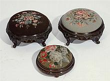 A PAIR OF VICTORIAN CARVED MAHOGANY FOOTSTOOLS with needlework seats, 29cm