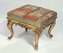 AN ANTIQUE GILTWOOD DRESSING STOOL with acanthus scroll ornament and needle