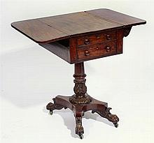 A GEORGE IV MAHOGANY WORK TABLE with fitted drawer and leaf carved ornament
