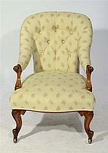 A VICTORIAN CARVED WALNUT ELBOW CHAIR with persian leaf pattern upholstery,