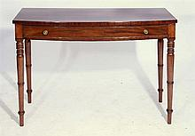 A MAHOGANY BOW FRONTED SIDE TABLE with ebony line inlay and ring turned leg