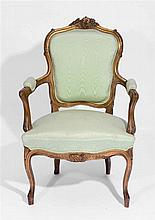 A FRENCH GILTWOOD FAUTEUIL with foliate scroll ornament, c1900, 60cm d x 95