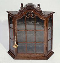 A DUTCH OAK WALL MOUNTED VITRINE with three shaped shelves, c1800, 80cm w x