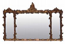 A ROCOCO GILTWOOD THREE SECTIONAL OVERMANTEL MIRROR with scallop shell and