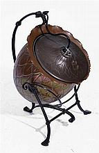 A COPPER AND WROUGHT IRON COAL SCUTTLE   attributed to Christopher Dresser