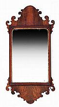 A GEORGE III FRET FRAME WALL MIRROR with old plate and gilded ornament, 89
