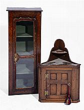 AN OLD OAK WALL CABINET with glazed panelled door, 95cm h x 37cm w; and a p