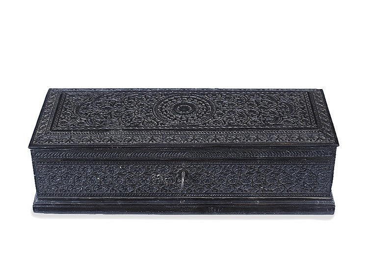 An indian carved wooden scribes or glove box with hinged ris