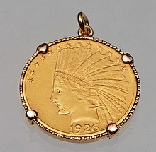 A GOLD PENDANT set with a United States gold Ten