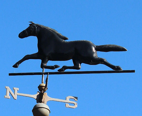 A BLACK PAINTED WEATHER VANE in the form of a