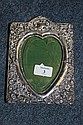 A SILVER MOUNTED PHOTOGRAPH FRAME with heart