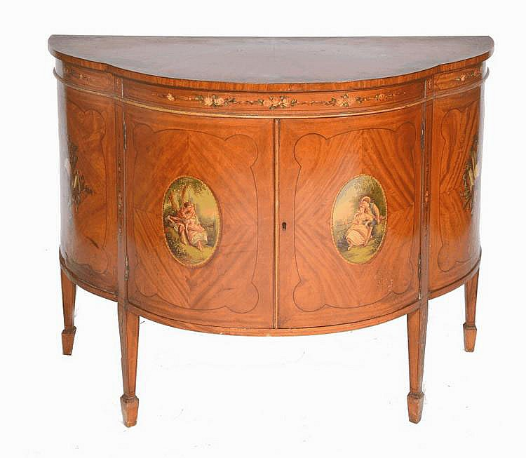 AN EDWARDIAN SATINWOOD DEMI-LUNE SIDE CABINET of