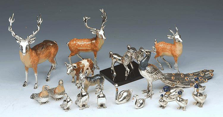 A SILVER AND ENAMEL DECORATED SMALL MODEL of a cow