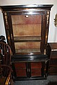 A VICTORIAN EBONISED TWO TIER CABINET, both