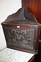 A LATE VICTORIAN OAK CORNER CUPBOARD enclosed by