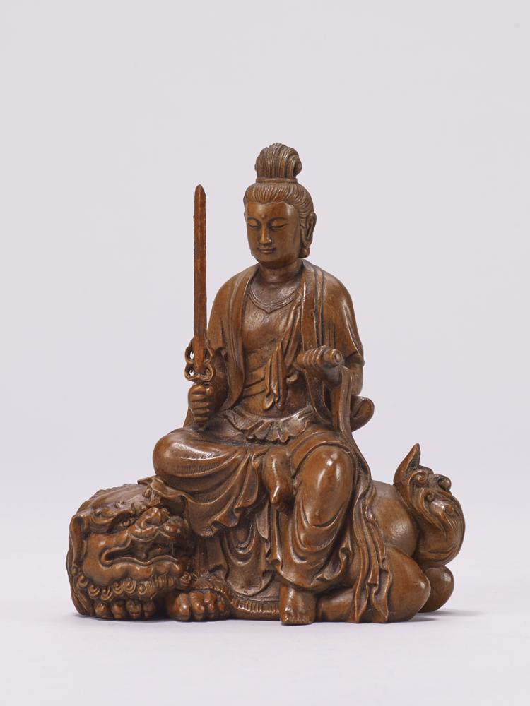 A boxwood carved bodhisattva statue