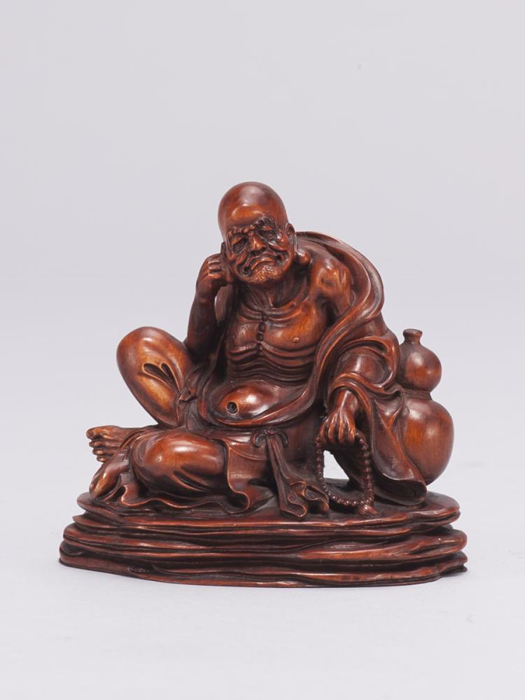A boxwood carved luo han statue