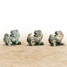 A GROUP OF THREE CHINESE BRONZE FREE-STANDING LION FIGURES