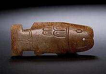 A WHITE AND RUSSET JADE ARCHAISTIC FISH