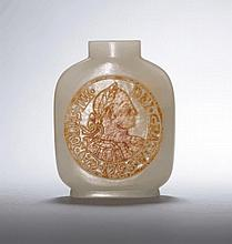 A WHITE AND RUSSET JADE COIN-FORM SNUFF BOTTLE