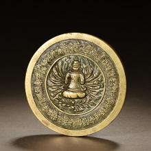 A CHINESE BRONZE CUNDHI MIRROR