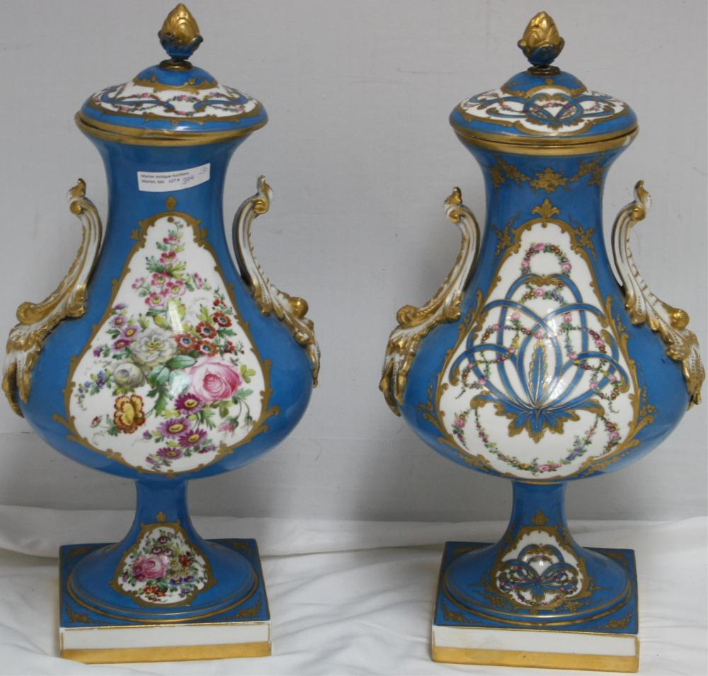 PAIR OF 19TH CENTURY SEVRES COVERED URNS, HAND