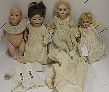 FOUR GERMAN BISQUE HEAD BABY DOLLS,
